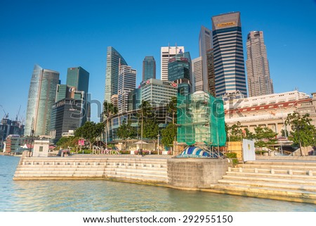 SINGAPORE-June 26, 2015: The Merlion fountain in Singapore. Merlion is a imaginary creature with the head of a lion,seen as a symbol of Singapore which is in the process of restoration. - stock photo