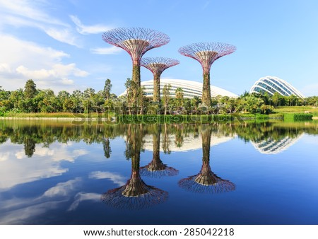"SINGAPORE - JUNE,6: The view of the group of artificial trees are located around the water  where called "" GARDEN BY THE BAY "" . There are many tourists come to visit everyday. SINGAPORE JUNE,6 2015 - stock photo"