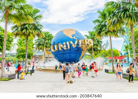 SINGAPORE - JUNE 25: Tourists and theme park visitors taking pictures of the large rotating globe fountain in front of Universal Studios on JUNE 25, 2014 in Sentosa island, Singapore - stock photo