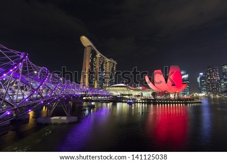 SINGAPORE - Mar 2013:Front view of the Marina Bay Sands Resort at the mouth of the Singapore River Mar 12, 2013 in Singapore. This waterfront resort and casino is a tourist attraction. - stock photo
