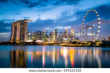 SINGAPORE-MAR 30: Marina Bay Sands hotel Singapore landmark, Sunset view of The Supertree Grove, Cloud Forest & Flower Dome at Gardens by the Bay on March 30, 2015 in Singapore City. - stock photo