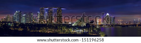 SINGAPORE - MAR 19 : Night View of the Marina Bay Sands Resort and Gardens by the Bay along Singapore River on March 19th, 2013 in Singapore. This waterfront conservatory is a big tourist attraction. - stock photo