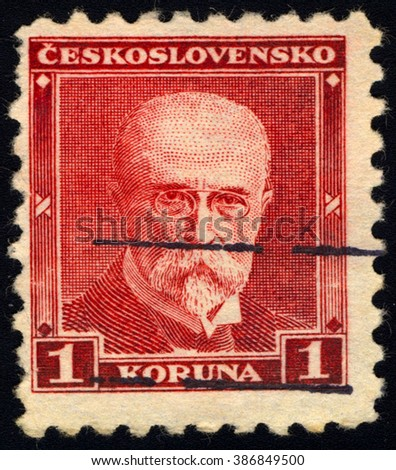 SINGAPORE - MARCH 7, 2016:  A stamp printed in Czechoslovakia shows 1st President of Czechoslovakia - Thomas Masaryk, circa 1930 - stock photo
