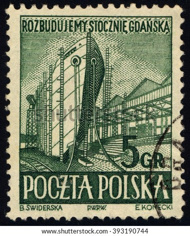 SINGAPORE - MARCH 20, 2016: A stamp printed in Poland to commemorate Gdansk Shipyards issue shows shipbuilding, circa 1952. - stock photo