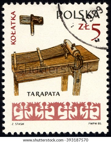 SINGAPORE - MARCH 20, 2016: A stamp printed in Poland to commemorate Musical Instruments issue shows Rattle and tarapata, circa 1985 - stock photo