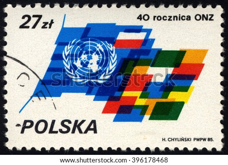 SINGAPORE - MARCH 26, 2016: A stamp printed in Poland to commemorate 40th Anniversary of United Nation, circa 1985 - stock photo