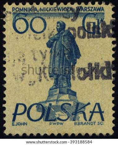 SINGAPORE - MARCH 20, 2016: A stamp printed in Poland to commemorate Warsaw Monuments issue shows Mickiewicz monument, circa 1955 - stock photo