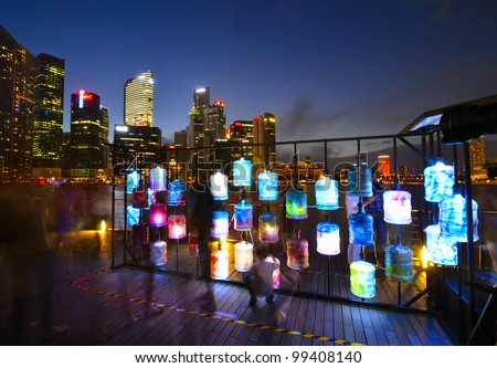 SINGAPORE -MARCH 31:Asia's First Sustainable Light Art Festival at Marina Bay March 31, 2012 in Singapore.The festival aims to celebrate the nightscape with the use of energy-efficient lighting. - stock photo