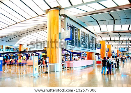 SINGAPORE - MARCH 05 : Changi International Airport on March 05, 2013 in Singapore. Changi Airport serves more than 100 airlines operating 6,100 weekly flights connecting Singapore to over 220 cities - stock photo