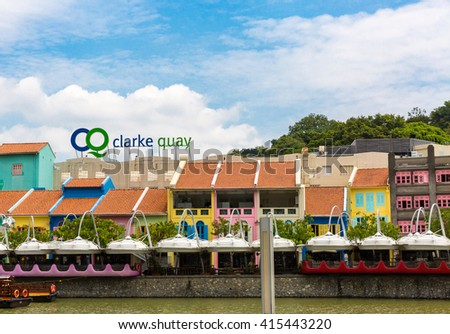 SINGAPORE - MARCH 26,2016 : Colorful bars and restaurants dot the Singapore River along Clarke Quay MARCH 26,2016. The area used to be a commercial center during the colonial era. - stock photo