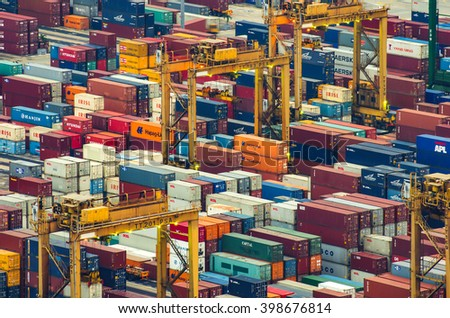 SINGAPORE - MARCH 23, 2016 : import and export container box at Port Keppel, Singapore. night time scene. motion blur. - stock photo