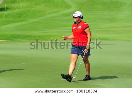 SINGAPORE - MARCH 2: Korean player Ha Na Jang happy with her completion of hole 3 during HSBC Women's Champions at Sentosa Golf Club Serapong Course March 2, 2014 in Singapore