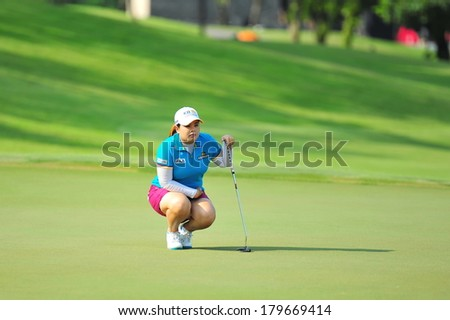 SINGAPORE - MARCH 2: Korean player Inbee Park aiming at the green during HSBC Women's Champions at Sentosa Golf Club Serapong Course March 2, 2014 in Singapore