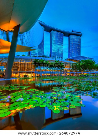 SINGAPORE  - MARCH 25: Marina Bay Sands, an integrated resort fronting Marina Bay, March 25, 2015, Singapore. The world's most expensive standalone casino property. - stock photo