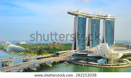 SINGAPORE - MARCH 03, 2013: Marina Bay Sands and Garden by the bay in Singapore. Marina Bay Sands Resort is billed as the world's most expensive standalone casino property at S$8 billion - stock photo