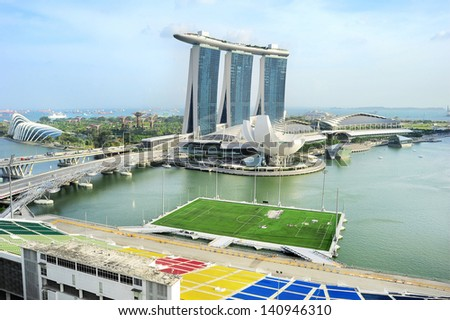 SINGAPORE - MARCH 08: Marina Bay Sands Resort on March 08, 2013 in Singapore. It is billed as the world's most expensive standalone casino property at S$8 billion - stock photo