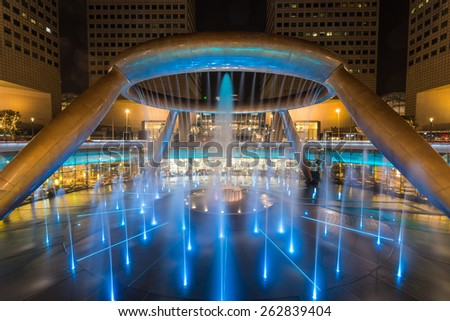 SINGAPORE - MARCH 1, 2015: Night scene of Fountain of Wealth at Suntec city, Singapore. Fountain of Wealth is one of the most famous tourist attraction in Singapore.
