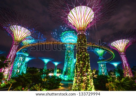 SINGAPORE - MARCH 19: Night view of The Supertree Grove at Gardens by the Bay on March 19, 2013 in Singapore. Spanning 101 hectares of reclaimed land in central Singapore, adjacent to Marina Bay hotel - stock photo