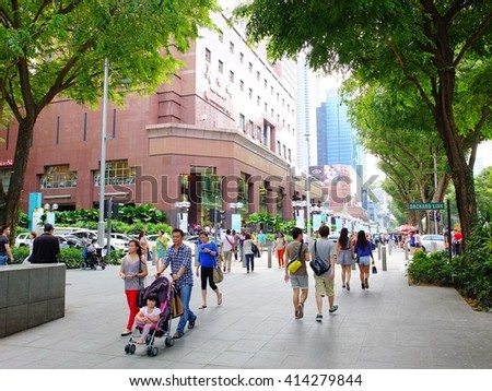 SINGAPORE - MARCH 8, 2013: Pedestrians walk on Orchard road, Singapore. This 2.2 kilometre street is the retail and entertainment hub of Singapore.