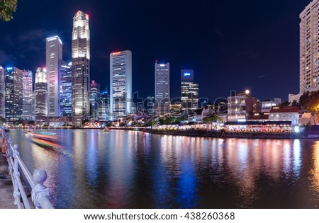 Singapore-March 12,2016 : Singapore city skyline with buildings in business district at night by Singapore river