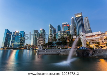 SINGAPORE - MARCH 1, 2015: Sunrise scene of Singapore skyline with merlion on march 1, 2015. Merlion fountain is one of the most famous tourist attraction in Singapore.