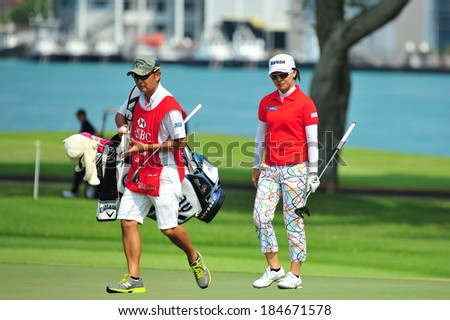 SINGAPORE - MARCH 2: Taiwanese player Teresa Lu walking with her caddy during HSBC Women's Champions at Sentosa Golf Club Serapong Course March 2, 2014 in Singapore