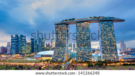 SINGAPORE-MARCH 19: The 6.3 biliion dollar (US) Marina Bay Sands Hotel dominates the skyline at Marina Bay on March 19 2013 in Singapore. - stock photo