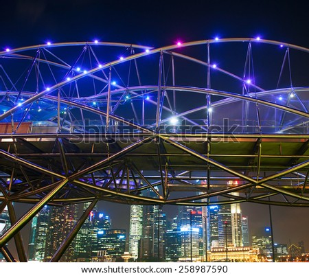 SINGAPORE - MARCH 06, 2013: The Helix Bridge at night  in Singapore. The Helix is fabricated from 650 tonnes of Duplex Stainless Steel and 1000 tonnes of carbon steel. - stock photo