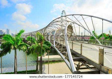 SINGAPORE - MARCH 08, 2013: The Helix Bridge in Singapore. Is a bridge in the Marina Bay. The Helix is fabricated from 650 tonnes of Duplex Stainless Steel and 1000 tonnes of carbon steel  - stock photo