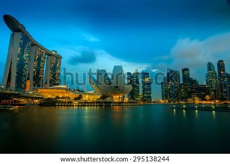 SINGAPORE - March 28,2015: The Helix Bridge, Marina bay sands at night. Marina Bay Sand iconic design has transformed Singapore's skyline. Designed by architect Moshe Safdie.  - stock photo