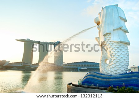 SINGAPORE - MARCH 08: The Merlion fountain in front of the Marina Bay Sands hotel on March 08, 2013 in Singapore. Merlion is a imaginary creature with the head of a lion, seen as a symbol of Singapore