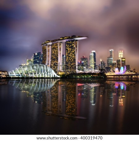 SINGAPORE - MARCH 25: Wonder Full light show at Marina Bay Sands, March 25, 2016, Singapore. Southeast Asia's largest light and water show. - stock photo