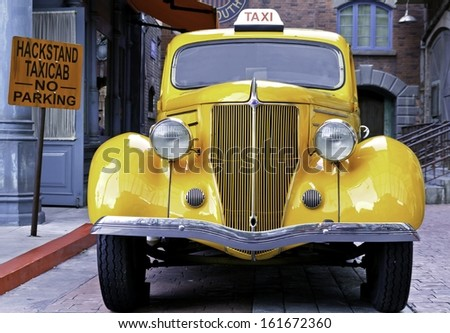 singapore May 5, 2012: A yellow vintage taxi car . - stock photo
