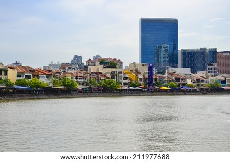 SINGAPORE-May 13: Business district and Boat Quay on May 13, 2014 in Singapore. Central Business District (CBD), located at south of Singapore River. - stock photo