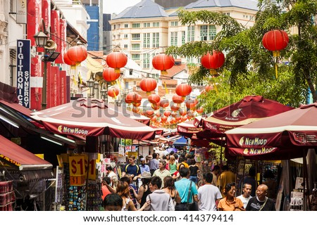 SINGAPORE - MAY 12, 2009: Chinatown with notable Chinese buildings, restaurants and decoration. Many tourists find there authentic food, clothes and other stuff and people engaging in daily activity. - stock photo