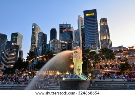 SINGAPORE - MAY 13,2014: Financial district skyscrapers and Merlion at Marina bay. The Merlion is a traditional creature with a lion head and a body of a fish, seen as a symbol of Singapore. - stock photo
