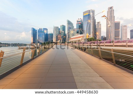SINGAPORE - MAY 15,2016: Financial district skyscrapers and the Jubilee Bridge at Merlion Park. A newly created pedestrian bridge at Marina Bay links Merlion Park to the waterfront promenade. - stock photo