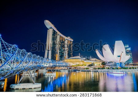 SINGAPORE, MAY 6: Helix bridge, Marina Bay Sands  hotel and the ArtScience Museum by night, famous touristic attractions of Singapore, on May 6, 2015 in Singapore - stock photo