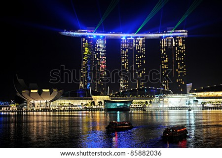 SINGAPORE - MAY 02: Marina Bay Sands Resort at night on May 02, 2011 in Singapore. It is billed as the world's most expensive standalone casino property at S$8 billion - stock photo