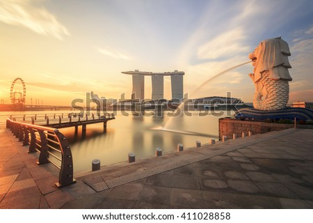 SINGAPORE - MAY 27 : Merlion fountain in front of the Marina Bay Sands hotel on May 27,2013 in Singapore. Merlion is a imaginary creature with the head of a lion, seen as a symbol of Singapore - stock photo