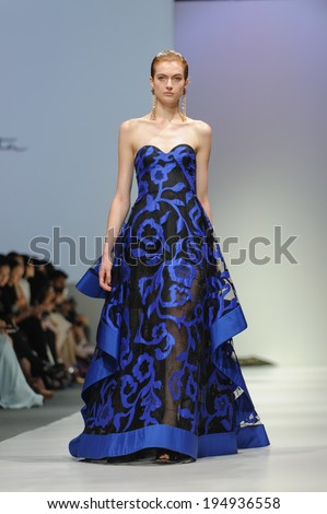 Singapore - May 18: Model showcasing fall collection from Oscar de la Renta at Audi Fashion Festival 2014 on May 18, 2014 in Singapore - stock photo