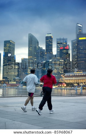 SINGAPORE- MAY 03: People run in the evening on May 3, 2011 in Singapore. On Dec. 4, 2011 will start Marathon Singapore 2011 - is the largest and most established race in this region.