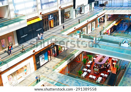 SINGAPORE - MAY 09, 2013: Shopping mall at Marina Bay Sands Resort in Singapore. It is billed as the world's most expensive standalone casino property at S$8 billion