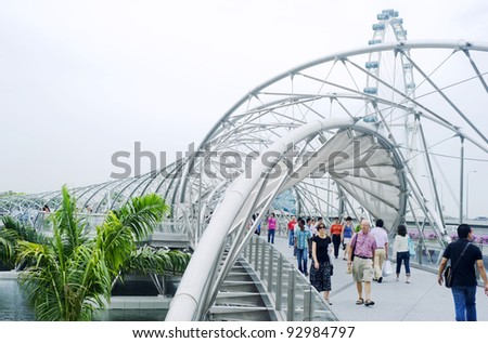 SINGAPORE - MAY 02: The Helix Bridge on  May 02, 2011 in Singapore. Is a bridge in the Marina Bay. The Helix is fabricated from 650 tonnes of Duplex Stainless Steel and 1000 tonnes of carbon steel.