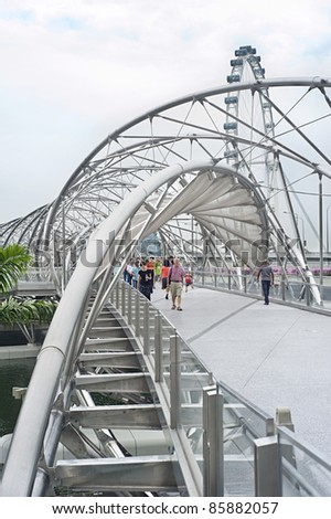 SINGAPORE - MAY 02:  The Helix Bridge on  May 02, 2011 in Singapore. Is a pedestrian bridge linking Marina Centre with Marina South in the Marina Bay. - stock photo