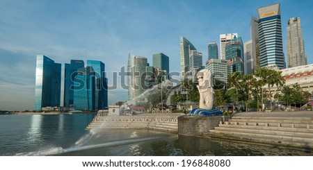 SINGAPORE - May 10: The Merlion fountain in front of the Marina Bay Sands hotel on May 10, 2014 in Singapore. Merlion is a imaginary creature with the head of a lion, seen as a symbol of Singapore