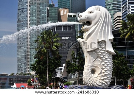 SINGAPORE MAY 12, 2012 : The Merlion is a traditional creature with a lion head and a body of a fish, seen as a symbol of Singapore. - stock photo