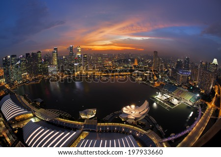 SINGAPORE - MAY 21: The Singapore skyline shines. Singapore has a highly developed market-based economy and is a center for commerce in Asia and globally May 21, 2014 in Singapore - stock photo
