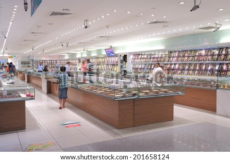SINGAPORE - 27 May, 2014: Unidentified people shop at gold shop at Mustafa Centre in Little India. Mustafa Centre is one of Singapore's 24 hour shopping mall opened in 1995 in Little India.  - stock photo