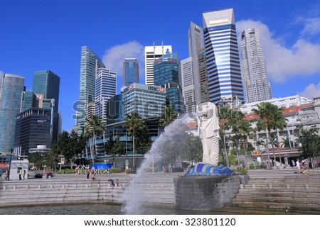 SINGAPORE - 28 MAY, 2014: Unidentified people sightsee Singapore Skyline and Merlion. Merlion is a symbol of Singapore with the head of a lion and the body of fish.